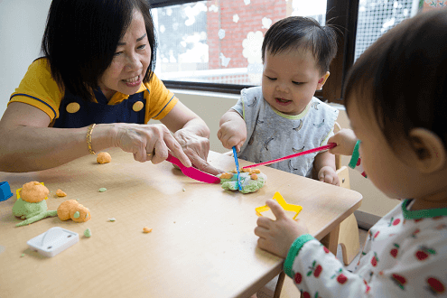 Dough play with the infants for fine motor skills development