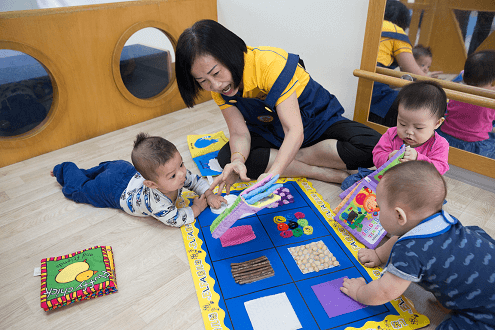 Making simple toys to support infants' development is Mdm Chan's passion