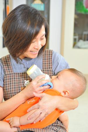 Hold baby slightly upright while feeding