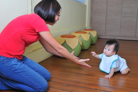 Baby crawling to educarer