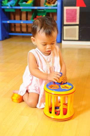 Toddler with sorting toy
